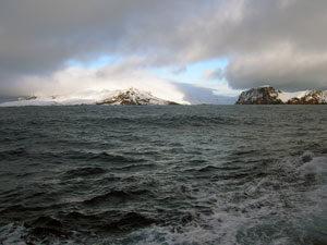 """The approach to Deception Island lies through a narrow opening between cliffs, called """"Neptune's Bellows."""" (Photo by Diane DiMassa, Massachusetts Maritime Academy)"""