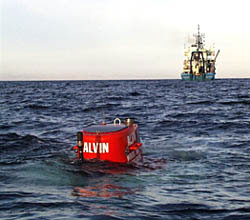 alvin in the water with atlantis in the background