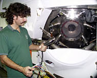 Lee Williams holding one of Alvin's penetrators. These penetrators are located around the viewports and are where wires from outside of Alvin's sphere come inside the sub.