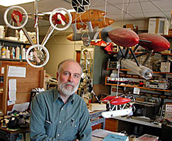 Al Bradley is surrounded by models of oceanographic instruments and vehicles that he invented. Photo by Dave Gray, WHOI.