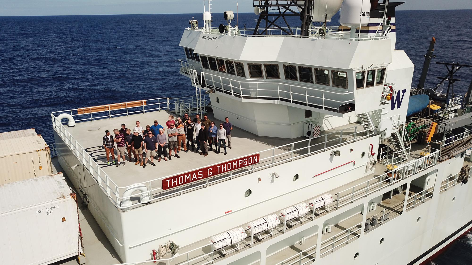 The science team on the Brothers volcano expedition takes time out from packing their gear for a team photo on the upper deck of R/V Thomas G. Thompson. (Photo by Erik Olsen)