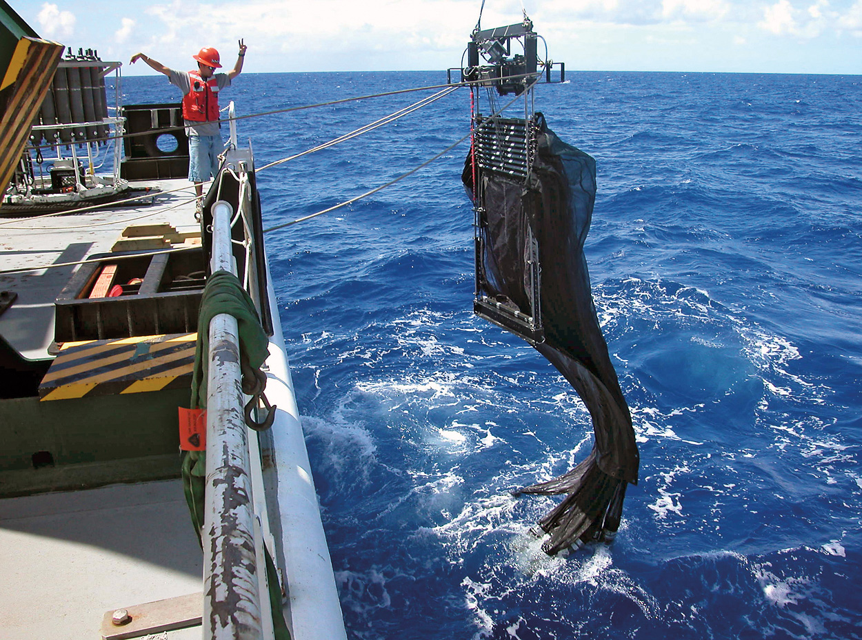 MOCNESS system suspended over the ship's side. Photo by Ken Buesseler, ©Woods Hole Oceanographic Institution