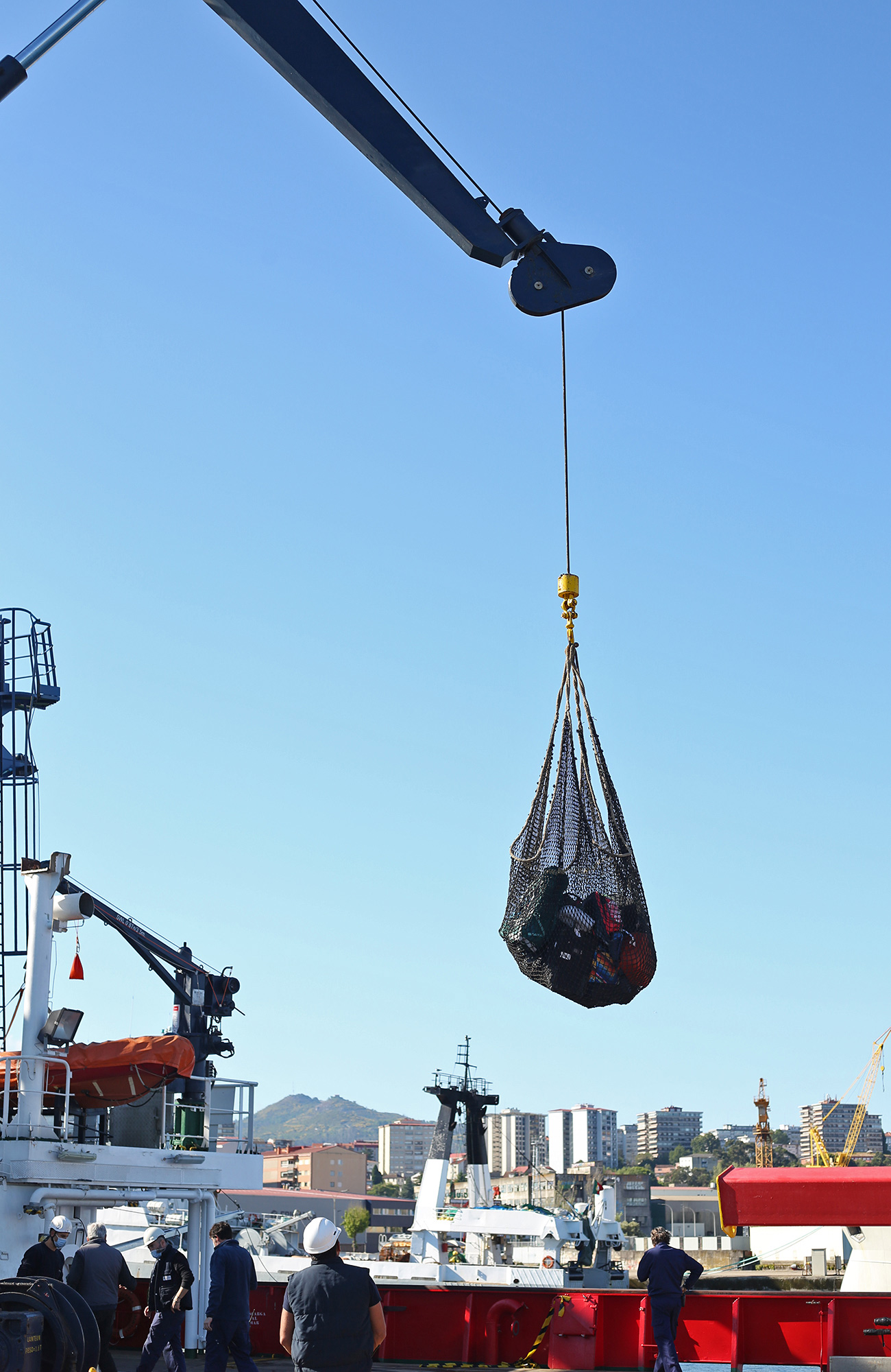 The crew of the R/V Sarmiento de Gamboa uses a crane to load all our luggage onto the ship.