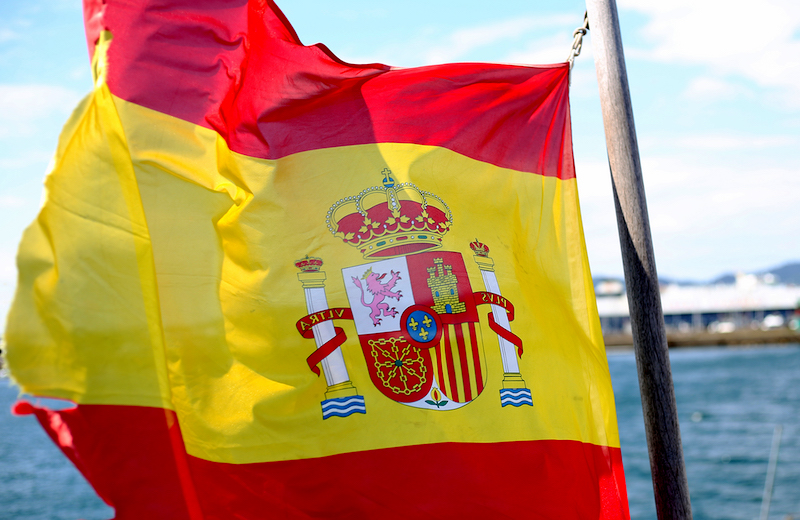 The Spanish flag blows in the breeze aboard the R/V Sarmiento de Gamboa. Photo by Marley Parker, @Woods Hole Oceanographic Institution