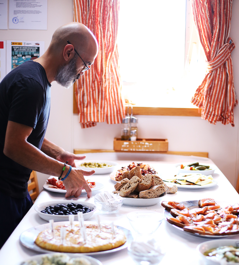 Juan María Antelo Martínez places arranges pinchos for the science team aboard the Sarmiento de Gamboa. Photo by Marley Parker, @Woods Hole Oceanographic Institution