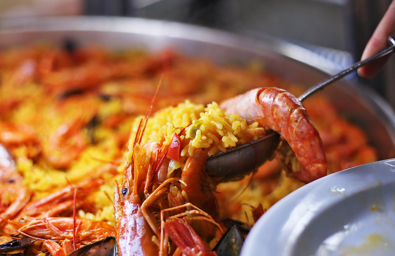 Paella, rice cooked with whole seafood, is a traditional Spanish dish. Photo by Marley Parker, @Woods Hole Oceanographic Institution
