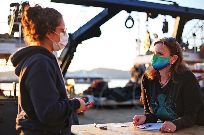 Michelle Cusolito chats with Laetitia Drago about her instruments on board the Sarmiento de Gamboa. Photo by Marley Parker, @Woods Hole Oceanographic Institution