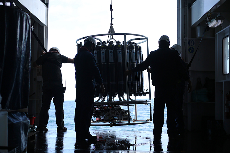 Technicians aboard the Sarmiento de Gamboa deploy the first CTD rosette after four days of bad weather. Photo by Marley Parker, @Woods Hole Oceanographic Institution