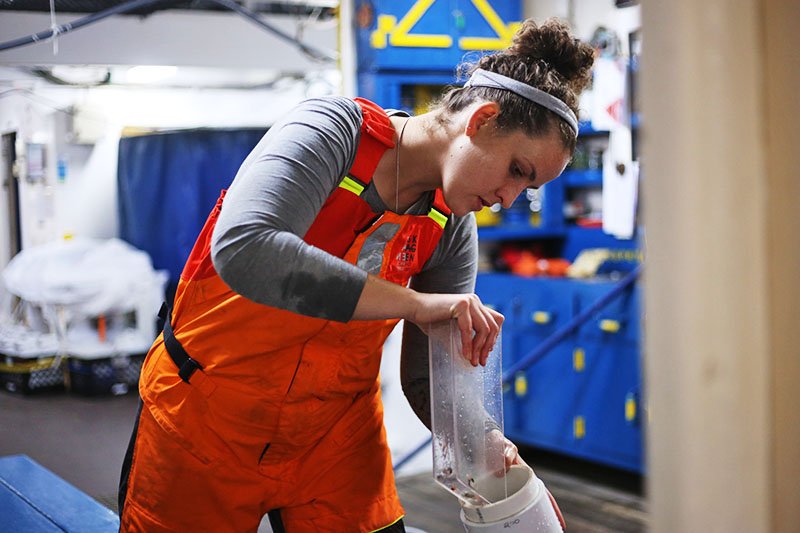 Kayla Gardner splits a MOCNESS sample in the wet lab. Photo by Marley Parker, @Woods Hole Oceanographic Institution