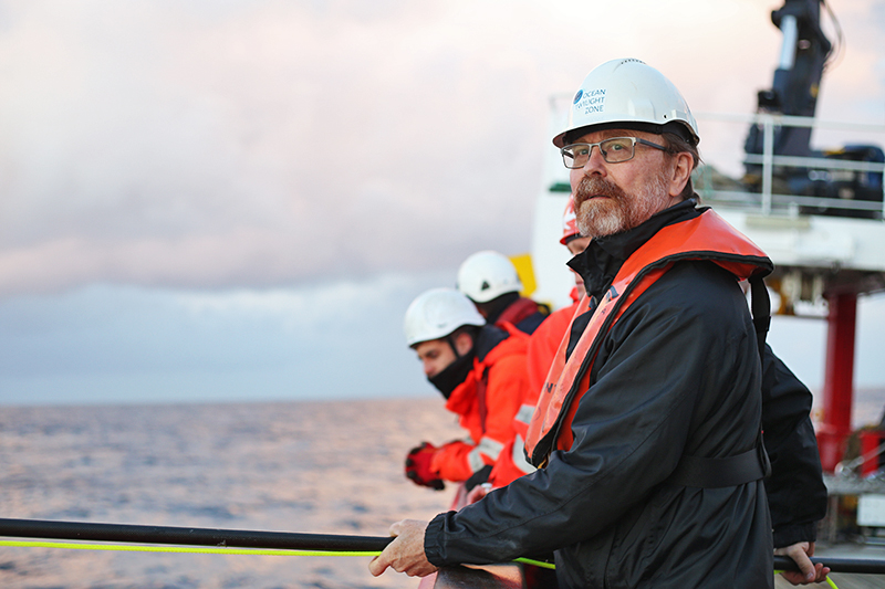 Ken Buesseler positions himself on the aft deck to recover the TZEx. Photo by Marley Parker, @Woods Hole Oceanographic Institution